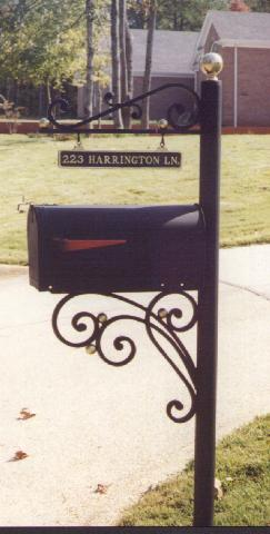 wrought iron mailbox and post