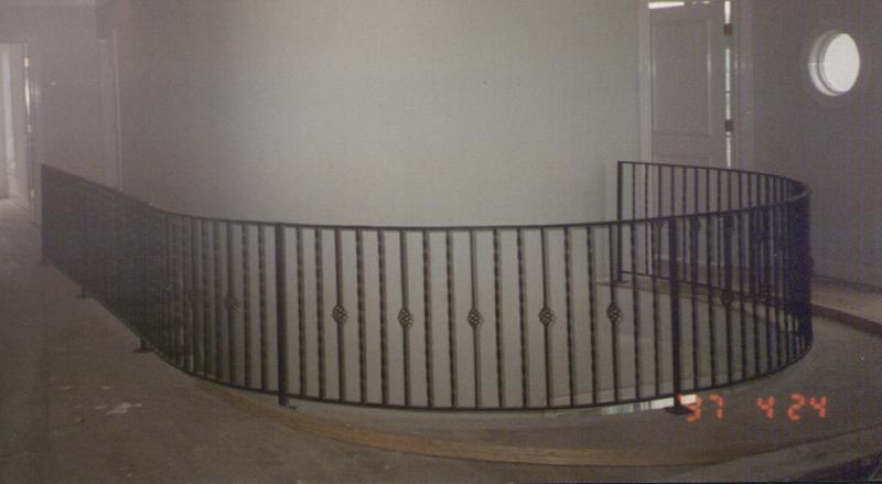 curved wrought iron rail