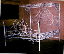 cast iron bed with rose design