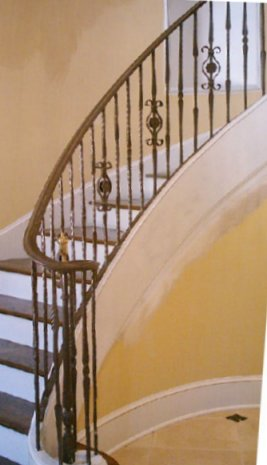 Wrought Iron Railing On A Curved Staircase And Landing