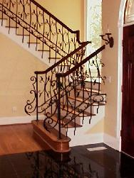 wrought iron railing with wood handrail