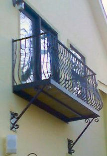 wrought iron balcony with hand forged iron railing
