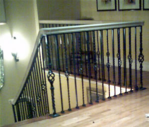 wrought iron and oak interior railing