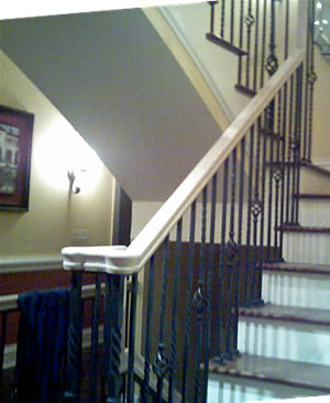 wrought iron atair rail with an oak handrail