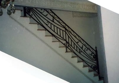 hand forged wrought iron railing on stairway