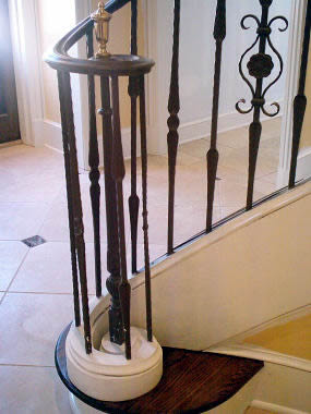 wrought iron lateral scroll on a curved railing